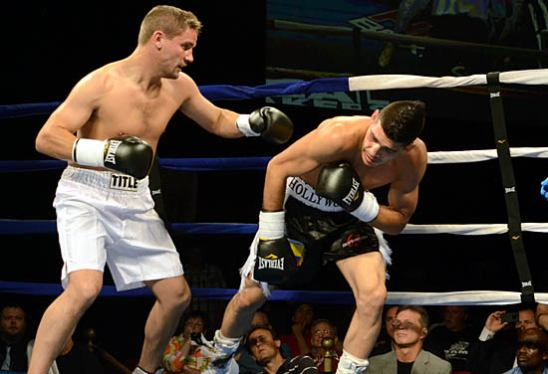 Adrian Hermann (L) brings the fight to Mike Jimenez