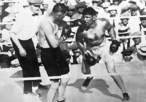 Jack Dempsey (right) attacks Tommy Gibbons (photo courtesy of Boxrec.com).