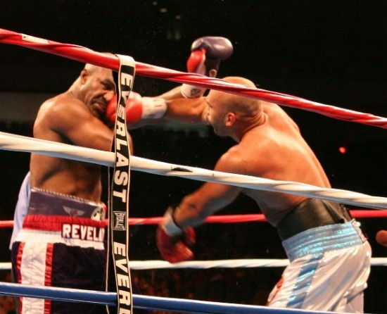 Fres Oquendo, at right, lands a right to the face of Evander Holyfield en route to losing a close and disputed decision to the former champ (photo by Juan C. Ayllon)
