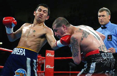 The late Mr. Tapia, at right, catching an uppercut from Barrera (photo from Cyber Boxing Zone archives)