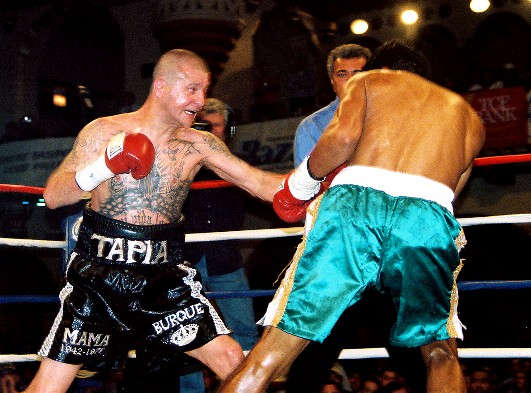 The late Johnny Tapia (left) slugs away in his bout versus Sandros Marcos (photo by Josh Walls)