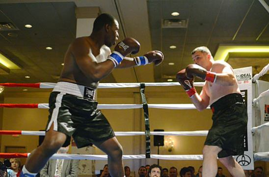 Elijah McCall (L) advances on Travis Fulton