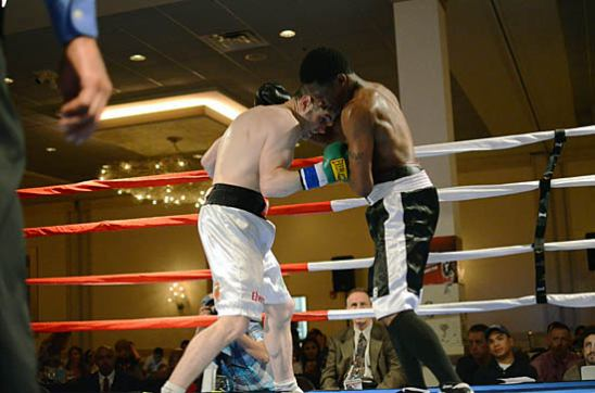 Coyle (L) stays close and goes for the body