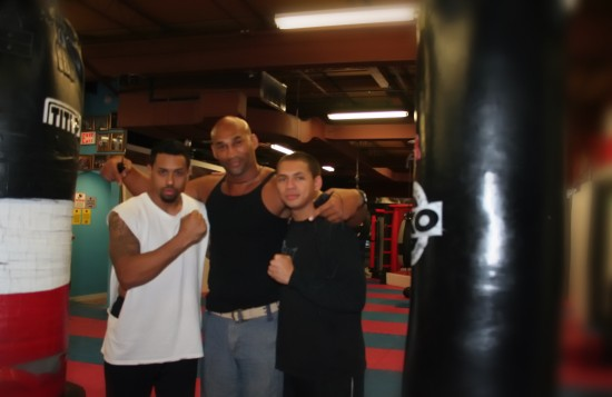 Oquendo (left) poses with two of his amateur fighters at Chicago Fight Club, Rico Gonzalez and Devin Wittenberg