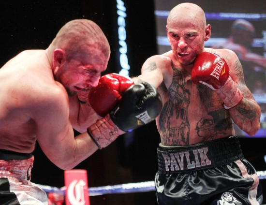 """Kelly Pavlik (right)stops Scott Sigmon at the end of the 7th round on Top Rank Live! - ESPN Friday Night Fights"""" from """"The Joint"""" at the Hard Rock Resort and Casino in Las Vegas, Friday, June 8 (Photo by Chris Farina - Top Rank, copyright 2012)"""