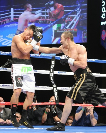 Beibut Shumenov (R) in action - (Photo by Emily Harney)