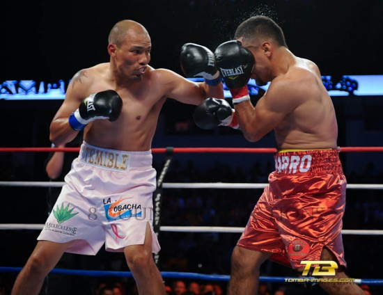 Jose Luis Castillo (left) bounces a left hook off the head of Ivan Popoca (photo by Tom Barnes).