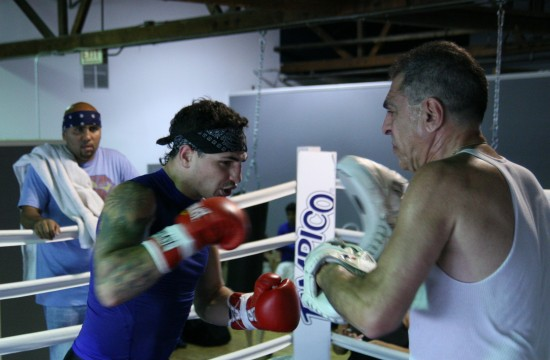 Donovan George, seen here hitting the focus mits with his father, Pete, looks forward to fighting Adonis Stevenson (photo by Juan C. Ayllon)