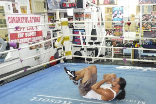 Thurman does crunches facing a wall that reads, 'Congratulations Jeff Lacy IBF Super Middleweight Champion&quot; (Photo by Belle Ayllon)  