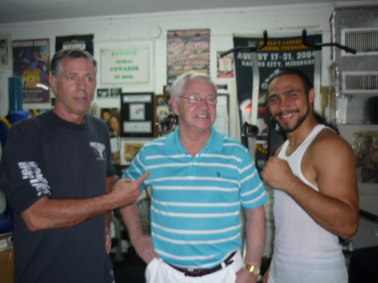 Boxing fan Billy Stevenson mugs with Birmingham and Thurman.