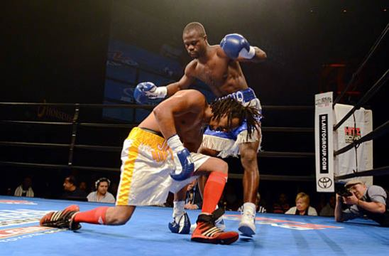 Abdulai Amidu gets out of the way after knocking down Clifford McPherson for the second time.