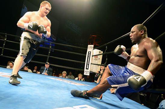 Fedosov (L) scores a knockdown