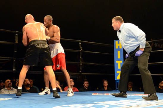 Bondas (L) lands a hook near the end of the bout as Spivey looks on