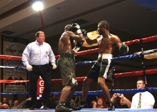 Echols, seen here at right, takes it to Michael Walker in 2008 (photo by Juan C. Ayllon)