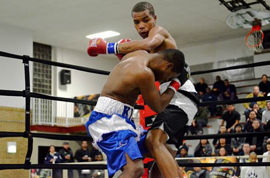 Ed Brown (top) launches his attack against veteran Dontre King