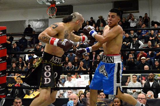 Adrian Granados (R) looks for a counter against the hard-charging Antonio Canas