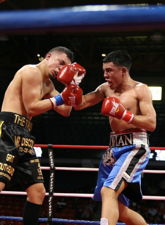 Adrian Granados (right) nailing Jaime Herrera in their thrilling fight in Chicago back in July (photo by Belle Ayllon)