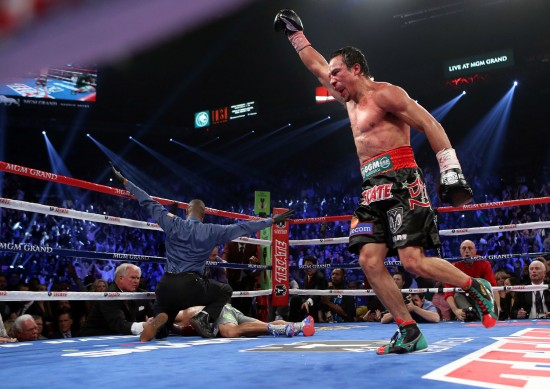 Juan Manuel Marquez(R) knocks out Manny Pacquiao in the final seconds of the 6th round Saturday at the MGM Grand in Las Vegas (photo by Chris Farina - Top Rank, Copyright 2012)
