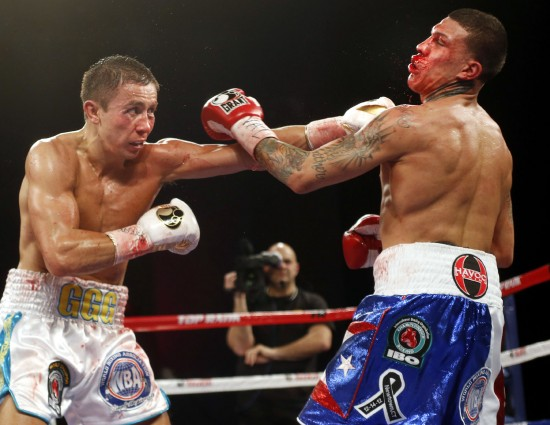 Gennady Golovkin at left shown here stopping Gabriel Rosado in the 7th round at The Theater at Madison Square Garden in New York (photo by Chris Farina - Top Rank, Copyright 2013)