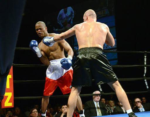 Michael Walker (L) tries to avoid a jab from Bondorovas