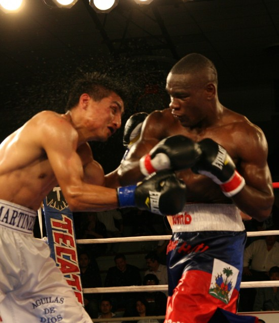 Cherry, at right, pummels Juan Carlos Martinez en route to a decision win in 2012 (photo by Belle Ayllon).