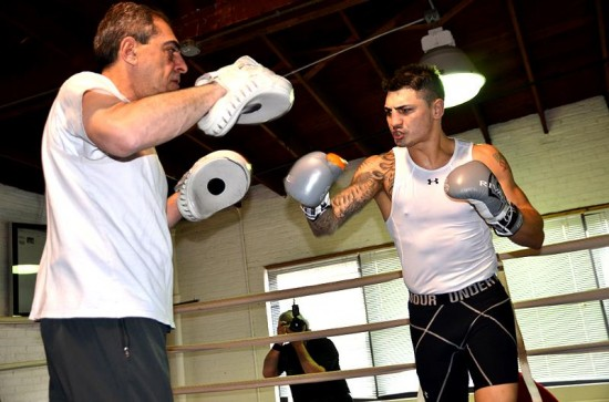 Donovan George, right, works the focus mitts with his father, Pete.