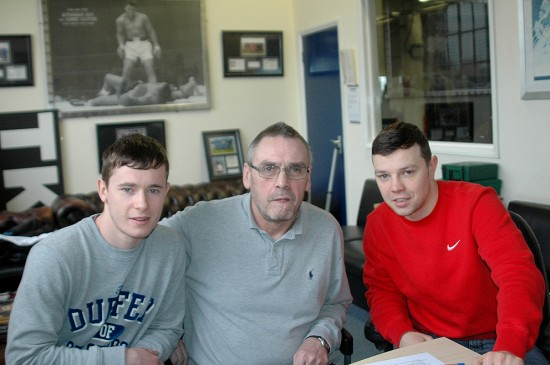 Anthony (L) and Paul Upton (R) flank Johnny Eames after signing pro papers.