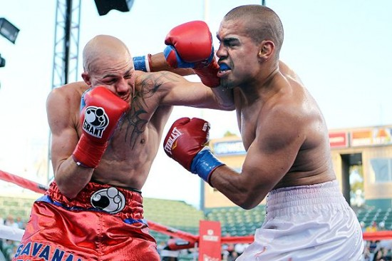 Cintron, at left, seen here mixing it up with Carlos Molina (photo courtesy of espn.go.com)