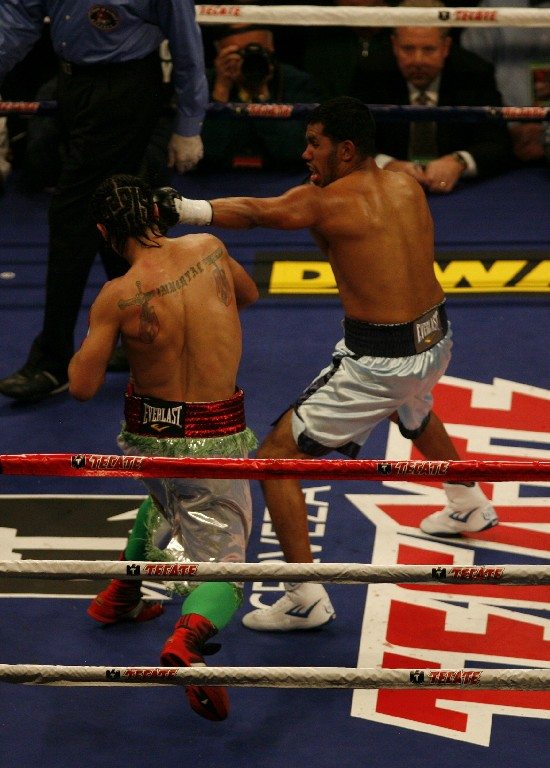 Juan Diaz, at right, seen here landing the jab on Paulie Malignaggi in their second bout (photo by Tom Glunz)