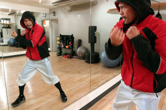 Nonito Donaire shadow boxing in a mirror (photo by Chris Farina - Top Rank, Copyright 2013)