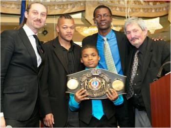 (L-R) Master of Ceremonies David Diamante, Brian Adams, Mark Breland, Bob Duffy and Breland's son.  (Picture by Peter Frutkoff)