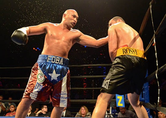 Fres Oquendo (L) launches a right en route to victory against Derric Rossy