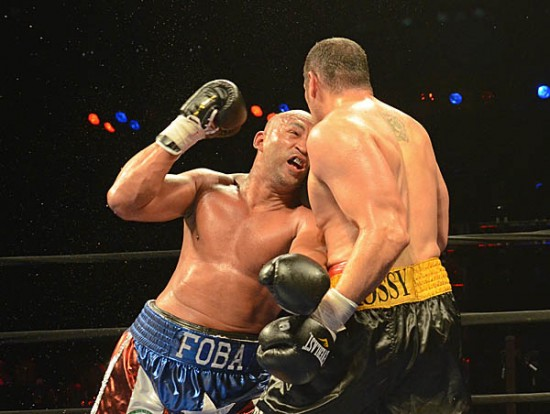 Oquendo (L) gets physical as he looks to end the bout in the tenth round