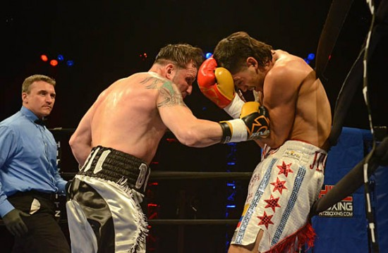 Richard Starnino (L) hammers away at Mike Jimenez's midsection