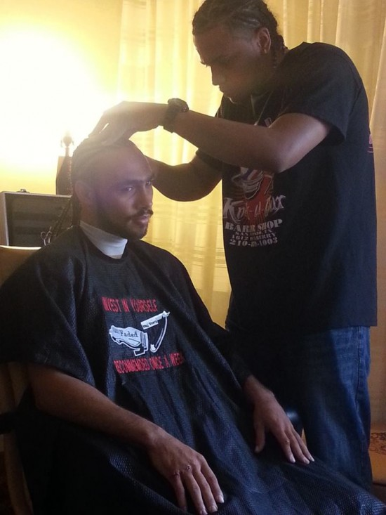 Undefeated welterweight knockout artist, Keith Thurman, gets a haircut in his room for tomorrow's broadcast fight with Diego Chavez (photo by Chris Getty)