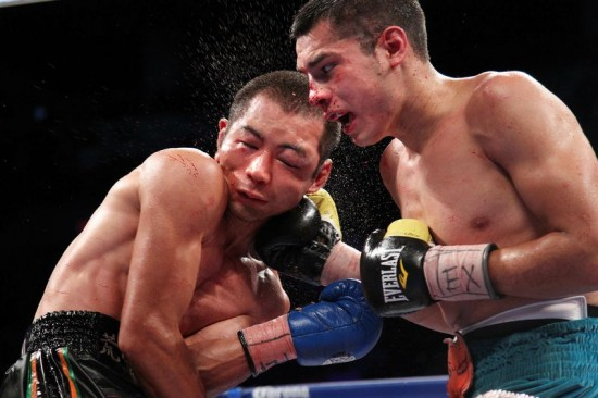 Figueroa lands a crunching right on Awakawa, at left (photo by Tom Casino/Showtime)