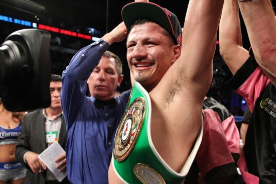 A victorious Soto-Karass has his gloved fist raised (photo by Tom Casino/Showtime)