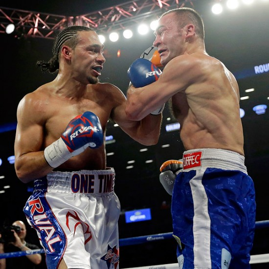 Keith Thurman, at left, shown here bouncing a right off the jaw of Jan Zaveck (photo courtesy of ESPN.Go.Com)