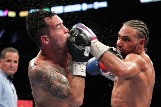 Keith Thurman rocks Diego Chaves moments before knocking him out (photo by Tom Casino/Showtime)
