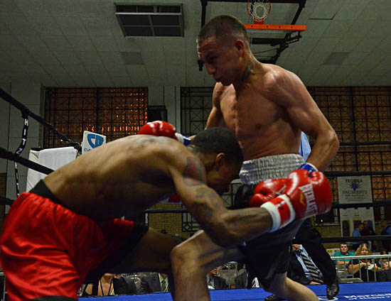 Brian Strickland (L) avoids an onslaught from Fidel Navarrete (R)