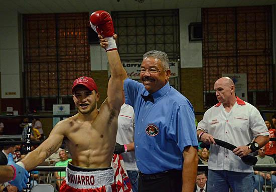 Referee Gerald Scott officially declares Roy Novarro the winner