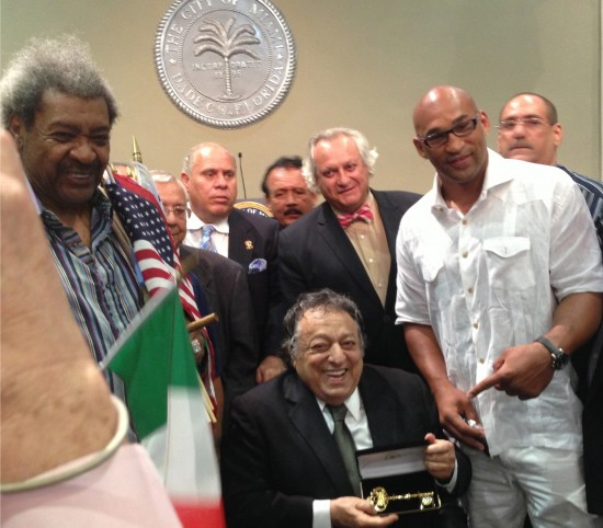 Don King, at left, and contender Fres Oquendo, at right, congratulate the seated Jose Sulaiman (photo courtesy of Tom Tsatas)