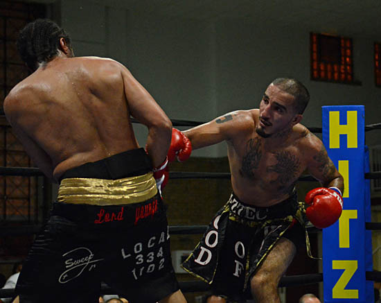 Antonio Canas (R) Pursues Greg Coverson Jr. En Route to a Six-Round Decision Win