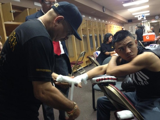 Trainer George Hernandez tapes the hands of Adrian Granados (Greg Rodil photo)