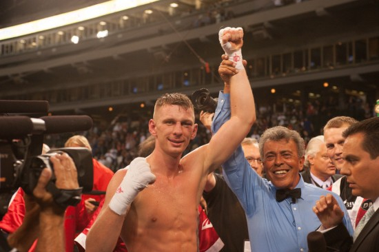 Referee Geno Rodriguez raises Fonfara's hand after the scintillating win (photo by Tom Barnes)