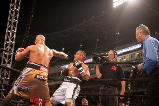 Szpilka drills Mollo as referee Gerald Scott looks on (Tom Barnes photo)