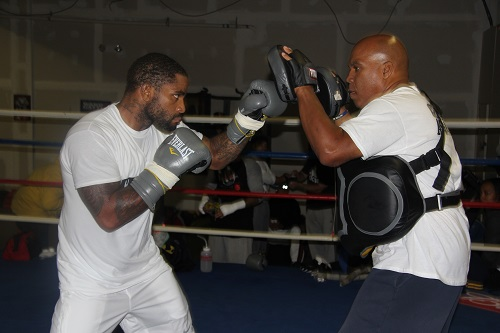 Curtis Stevens, at left, works with Andre Rozier (photo by Art Natalino)