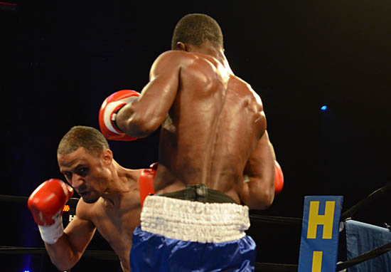 Rynell Griffin (L) attacks the body of Yakubu Amidu