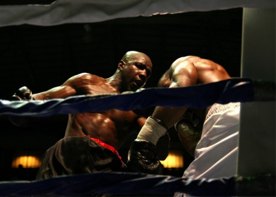 The late Michael Walker, at left, attacks Derrick Findley in losing a decision in 2010 (photo by Juan C. Ayllon)