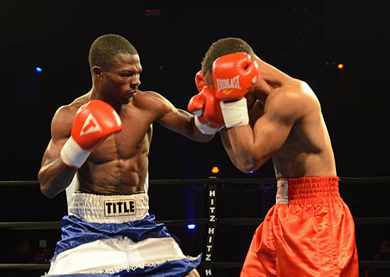 Yakubu Amidu (L) Pierces Rynell Griffin's Guard En Route to Victory